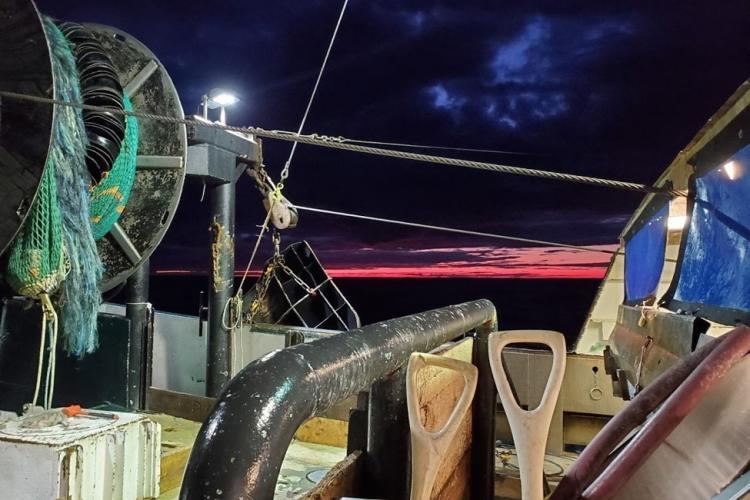 View of the deck of the  F/V Karen Elizabeth at sunrise.