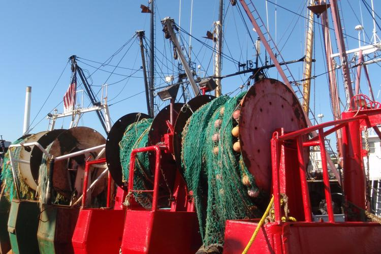 Stern view of  fishing vessells with their trawl nets.