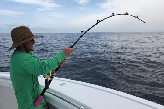 Man fishing off a boat