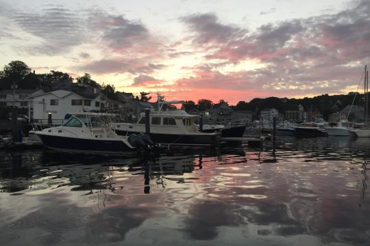 Boats in a harbor at sunrise