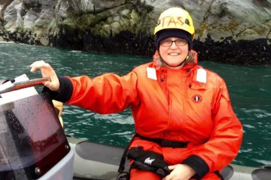 Teacher-at-Sea Mary Cook in zodiac.