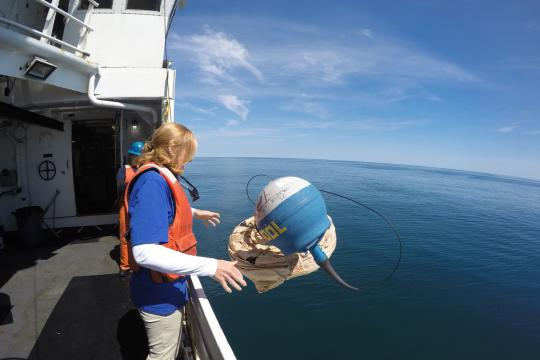 Susan Dee  lletting go of a buoy during a Teacher at Sea cruise.