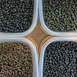 Four separated fishmeal pellets in containers.