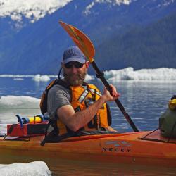 Photo of Jordan Watson kayaking.
