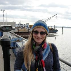 Picture of Alison Verkade standing on a dock near the ocean