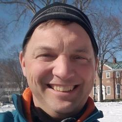 Picture of Bill McDavitt standing outside.