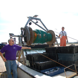 David Goethel in purple shirt next to the trawler Ellen Diane, partner Dan onboard.