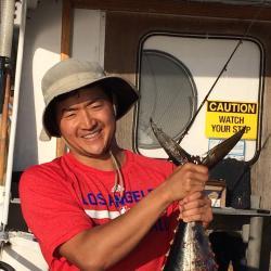 Peter Kuriyama holds catch