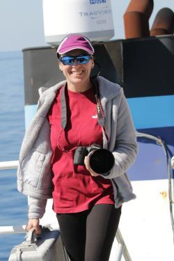 Laura Dias getting ready to photograph marine mammals during a research trip.
