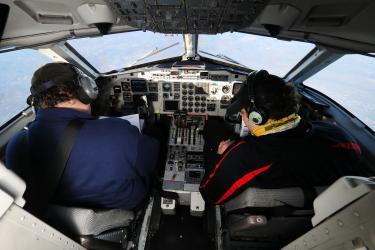 Pilots in cockpit en route to Texas