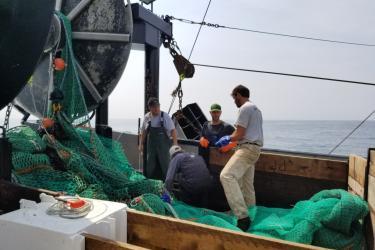 Discussing fishing operations on the F/V Karen Elizabeth.