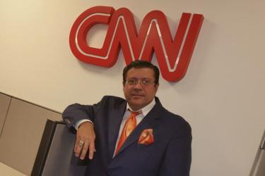Luis visiting the CNN studio in Atlanta for an interview while in a previous position.
