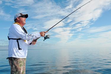 An angler wade fishes.