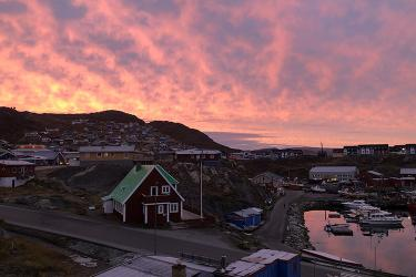 Sunrise over a small town in Greenland.