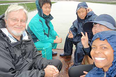 April Croxton (lower right) on a Connecticut marsh with a group of visiting Korean scientists and Gary Wikfors, a fellow researcher at the NEFSC Milford Laboratory.