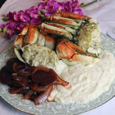 Dungeness crab served with mash potatoes on a plate