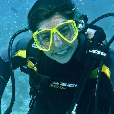 smiling woman in SCUBA gear underwater