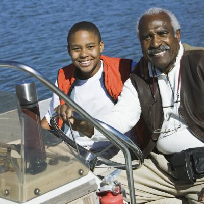 Grandfather and grandson on boat fishing.