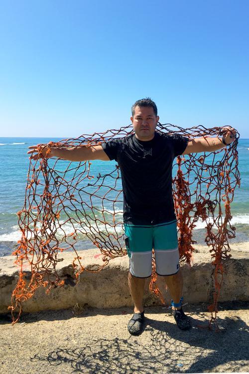 Endangered Species Biologist holding a net.