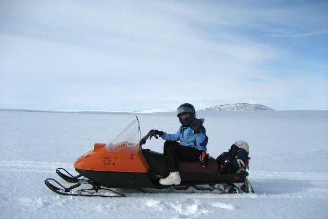 Dr. Jessica Cherry on a snowmachine in Alaska