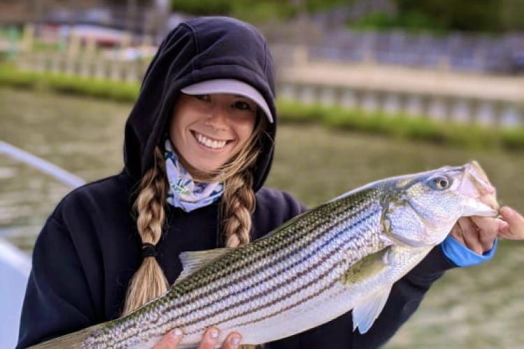 Girl holding striper