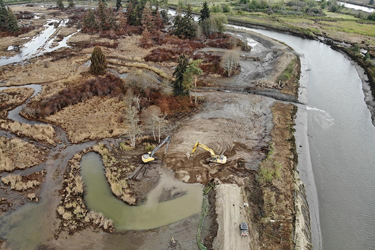 Aerial photo of heavy machinery working at restoration project site