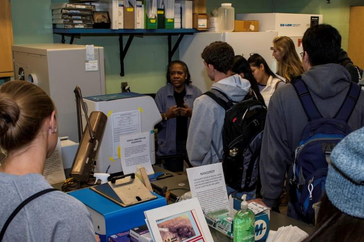 Sheila Stiles talks with students in her lab during an Open House in 2016.