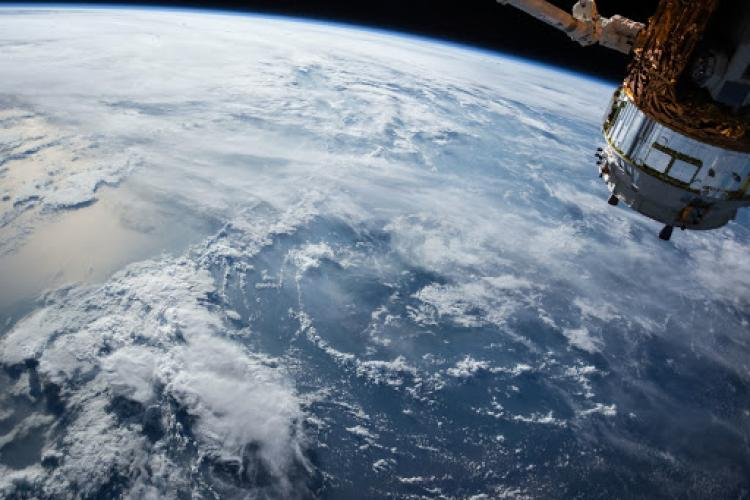 View of the earth's oceans and orbiting satellite.