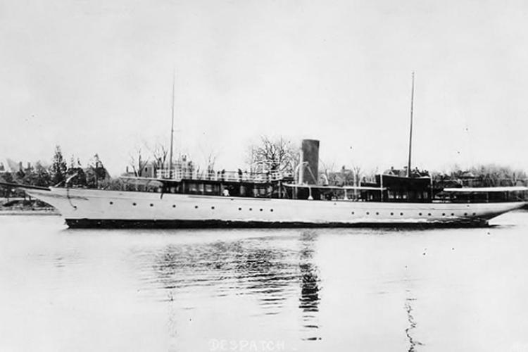 The  presidential yacht, the steamship  U.S.S. Despatch, underway in calm waters with a shoreline in the background.