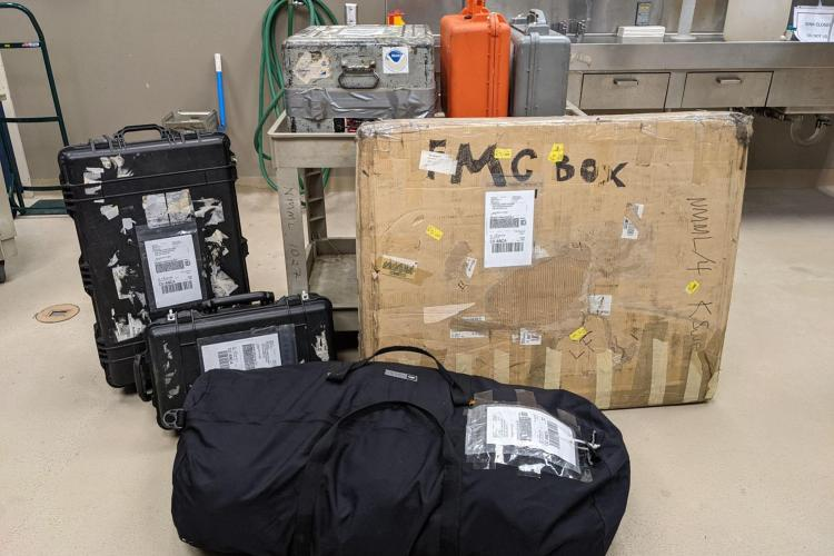 Photo of packed luggage and equipment boxes for aerial survey.