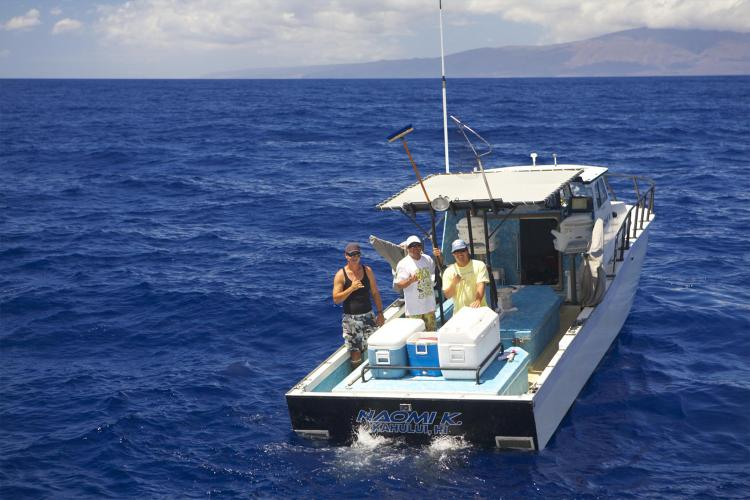 The cooperative research fishing vessel Naomi K and her crew in the waters of Maui Nui.