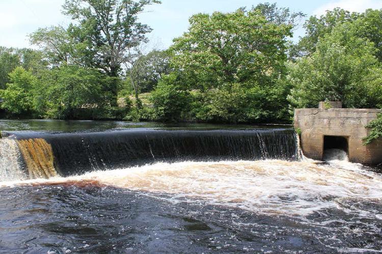 A river flows over a dam