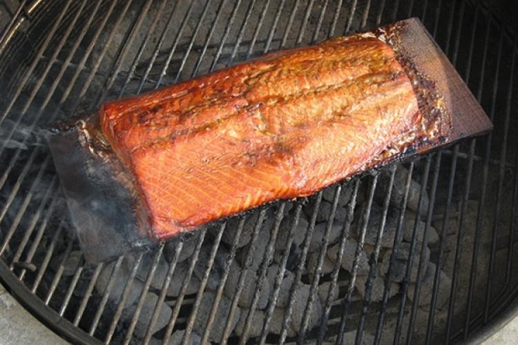 Grilled salmon on a cedar plank over coals.