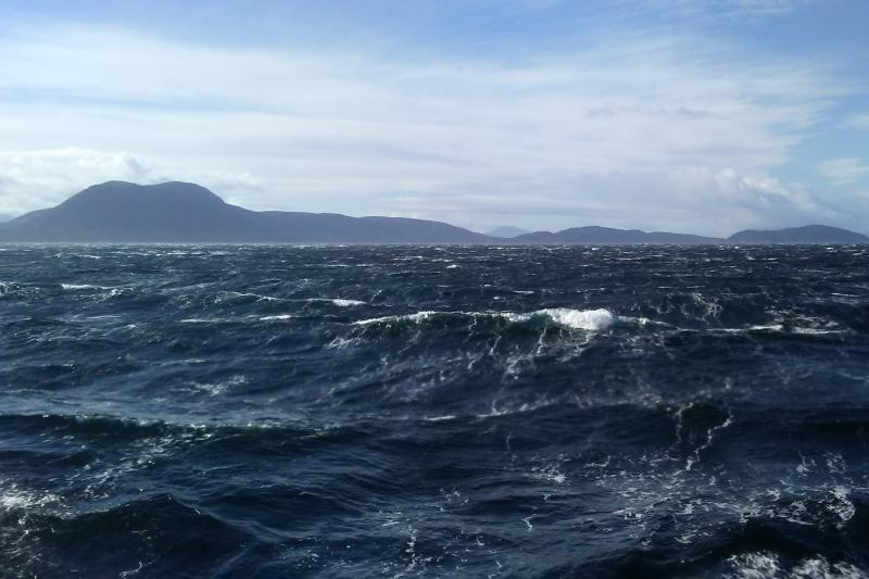 Photo of white capped waves off the coast of Alaska.