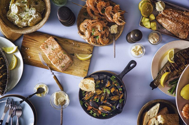 Table with fish and shellfish dishes