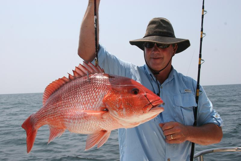 Recreational fisherman with red snapper.