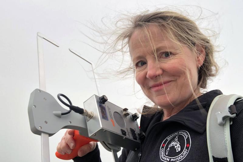 Sheila Thornton holding VHF receiver