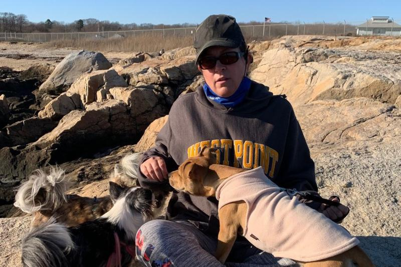Kate Zewinski enjoys her favorite nature spot with her three dogs.