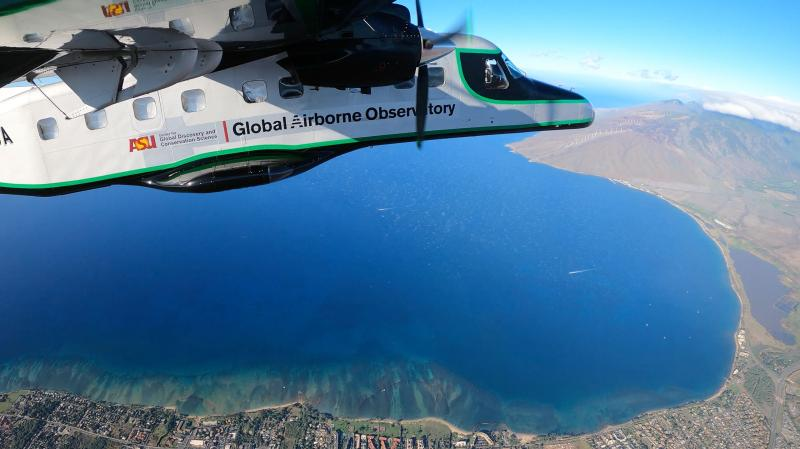 The ASU Global Airborne Observatory on a mapping mission over the North Maui Island coast.