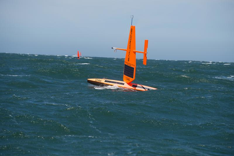 Photo of two saildrones in open water.