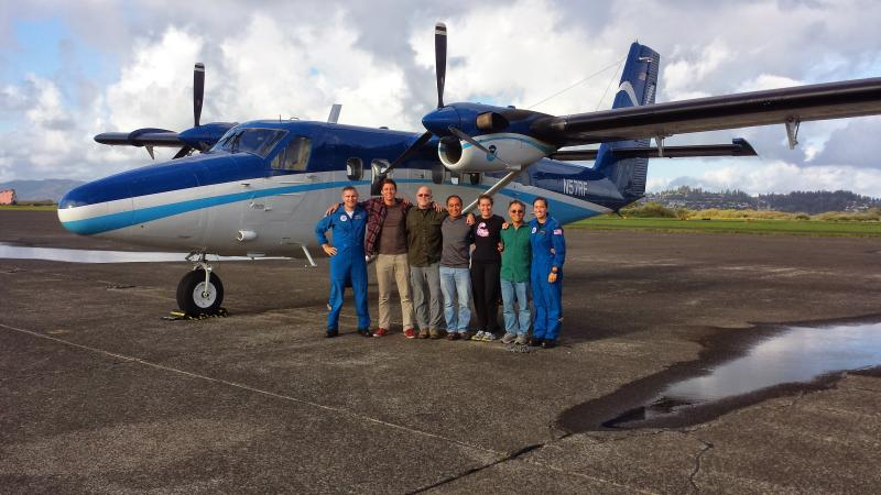 A NOAA aerial survey crew gathers in front of a NOAA Twin Otter aircraft during a stop in Astoria, Oregon.