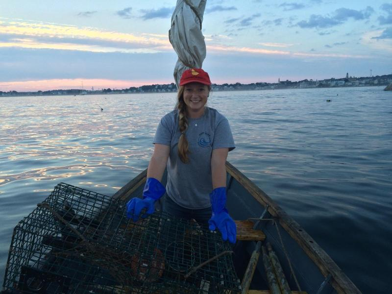 Samantha Tolken working on the water with lobster traps.