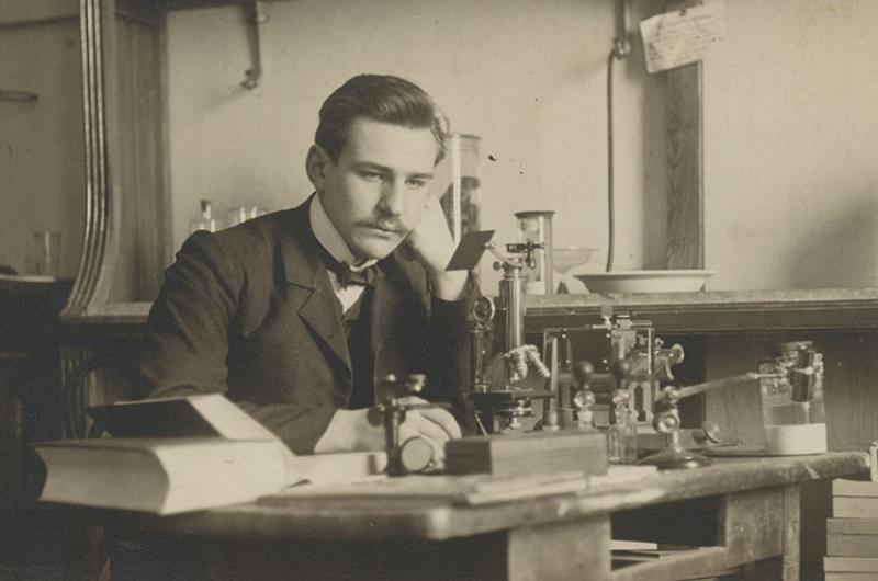 Paul Galtsoff early in his career sitting at a desk in a lab in Russia