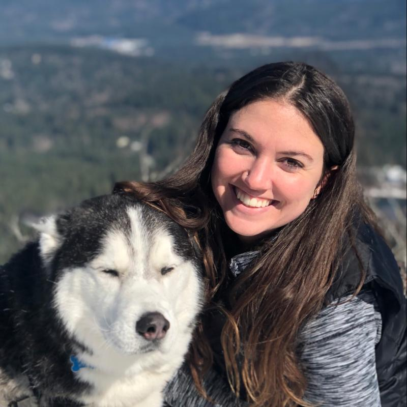 Photo of Burlyn Birkemeier with a Siberian Husky.