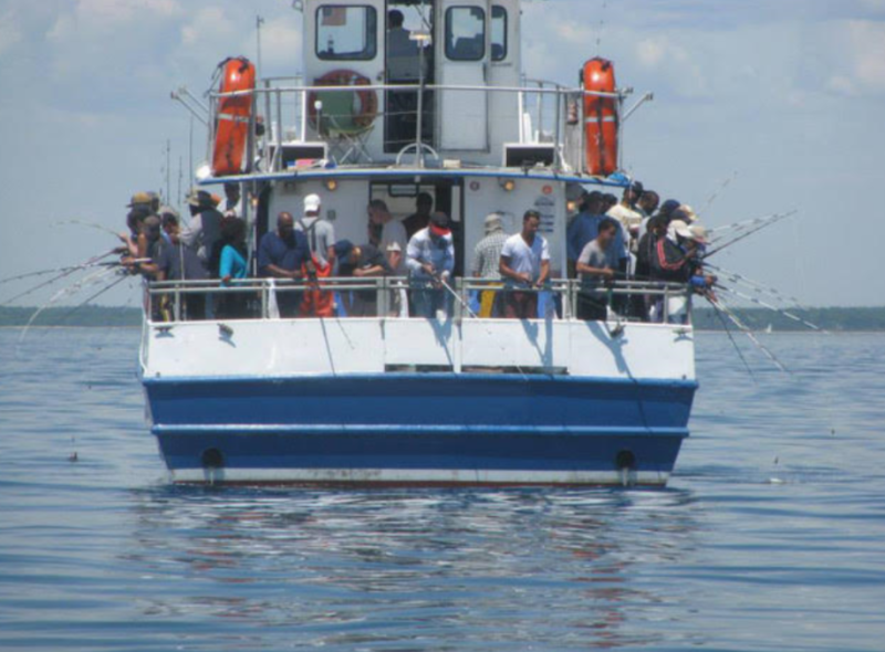 Picture of people fishing off of the boat