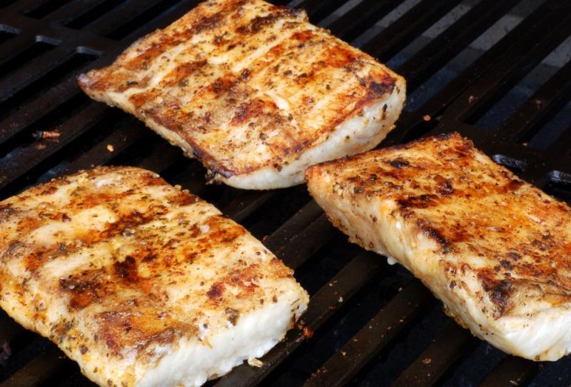 Mahi mahi filets on a grill.