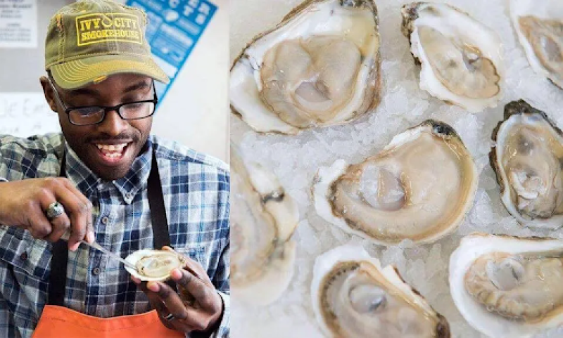 The Oyster Ninja, Gardner Douglas, carefully trims a raw oyster from its shell. Photo credit: Gardner Douglas.