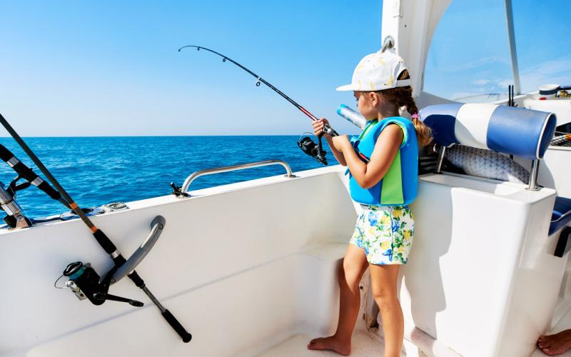 girl-fishing-from-boat