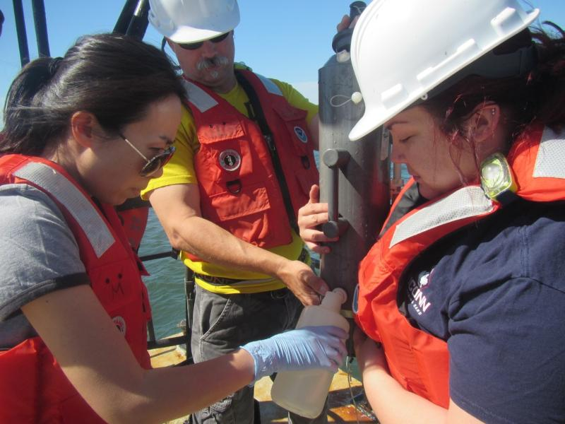 Yuan Liu collecting water samples with colleagues