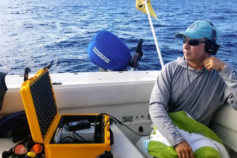 750x500-marc-lammers-listening-to-humpback-whale-songs-02-NOAA.jpg